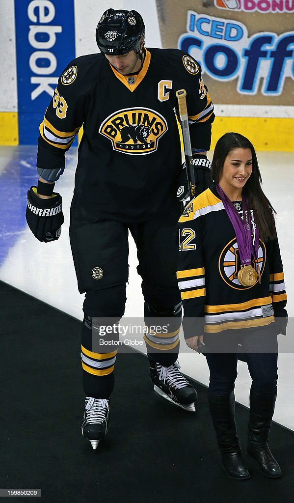 Bruins captain Zdeno Chara and Olympic Gold medal gymnast Aly Raisman provide a stark contrast in height as they come onto the ice together before the game for a ceremonial first puck dropping by Raisman. The Boston Bruins hosted the Winnipeg Jets in an NHL regular season game at TD Garden.