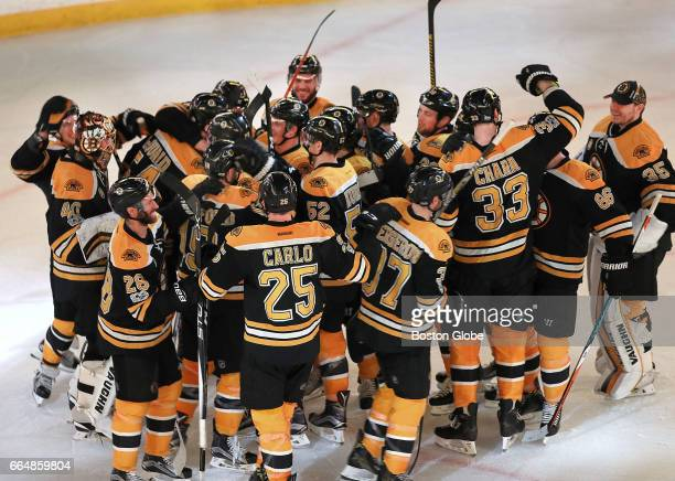 Bruins celebrate after beating the Lightning 40 and clinching a playoff spot The Boston Bruins host the Tampa Bay Lightning at TD Garden in Boston on...
