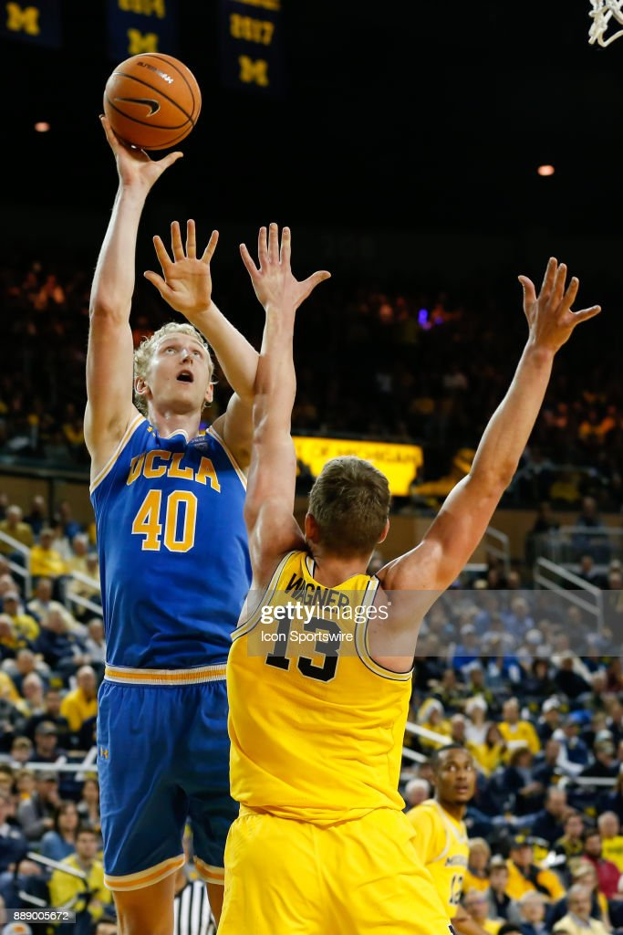 Bruins center Thomas Welsh (40) shoots over Michigan Wolverines forward Moritz Wagner (13) during the second half of a regular season non-conference basketball game between the UCLA Bruins and the Michigan Wolverines on December 9, 2017 at the Crisler Center in Ann Arbor, Michigan. Michigan defeated UCLA 78-69 in overtime.