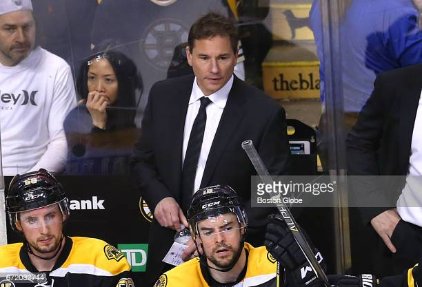 Bruins coach Bruce Cassidy is pictured at the end of the game after the loss to the Senators in overtime The Boston Bruins host the Ottawa Senators...
