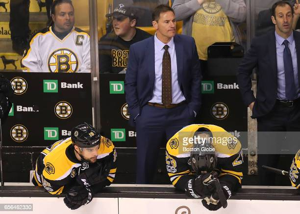 Bruins coach Bruce Cassidy looks frustrated along with his players Drew Stafford left and Dominic Moore with seconds left in the game and the Bruins...