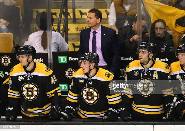 Bruins' coach Bruce Cassidy looks happy with what he sees standing behind David Krejci Brad Marchand and Patrice Bergeron with seconds left in the...