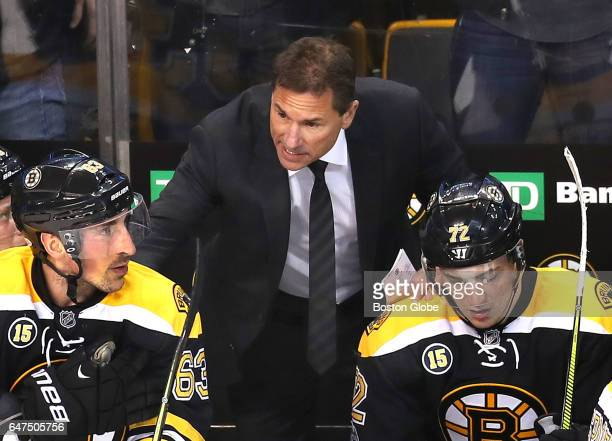 Bruins coach Bruce Cassidy speaks with Brad Marchand left and Frank Vatrano late in the third period with the Bruins down 21 The Boston Bruins host...