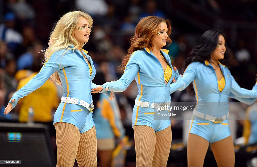 Bruins dance team members, including MaCall Manor (L), perform during the team's game against the Northwestern Wildcats during the Continental Tire Las Vegas Invitational at the Orleans Arena on November 29, 2013 in Las Vegas, Nevada. UCLA won 95-79.