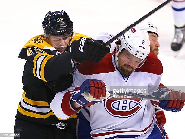 Bruins' David Krejci fights for a first period loose puck with Canadiens Douglas Murray The Boston Bruins play the Montreal Canadiens at TD Garden