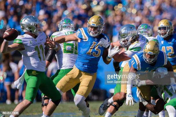 Bruins defensive lineman Jaelan Phillips and UCLA Bruins defensive lineman Keisean LucierSouth break through the Oregon line and go after Oregon...