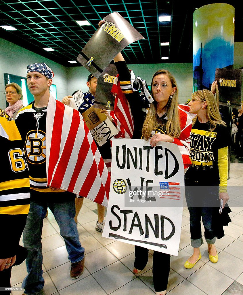 Bruins fans show their support for the recent Boston Marathon bombing victims before a game between the Buffalo Sabres and the Boston Bruins at TD Garden on April 17, 2013 in Boston, Massachusetts.