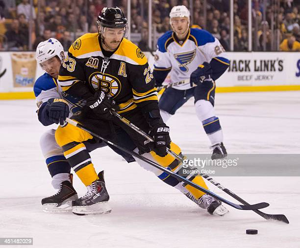 Bruins forward Chris Kelly takes a shot on goal with defensive pressure from Blues forward Derek Roy during the first period The Boston Bruins host...