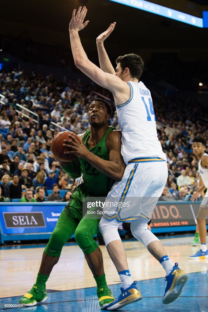 Bruins forward Gyorgy Goloman (14) defends as Oregon Ducks forward MiKyle McIntosh (22) drives to the basket during the game between the Oregon Ducks and the UCLA Bruins on February 17, 2018, at Pauley Pavilion in Los Angeles, CA.