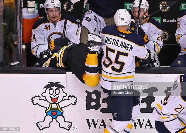 Bruins Frank Vatrano gets checked into the Sabres bench by Sabres Rasmus Ristolainen in the third period The Boston Bruins played the Buffalo Sabres...