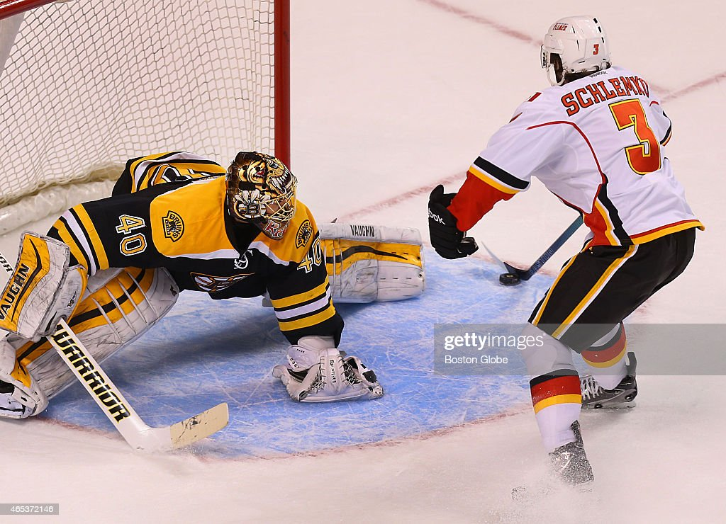 Bruins goalie Tuukka Rask can't get his pad on a shootout goal by the Flames' David Schlemko who onehands the puck in during the shootout