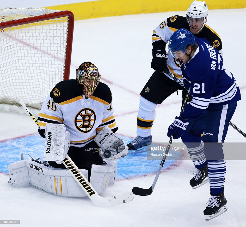 Bruins goalie Tuukka Rask makes a first period save as the Leafs James van Riemsdyk and the Bruins Wade Redden close in. The Boston Bruins visited the Toronto Maple Leafs for Game Three of the Stanley Cup Eastern Conference quarterfinal series at the Air Canada Centre.