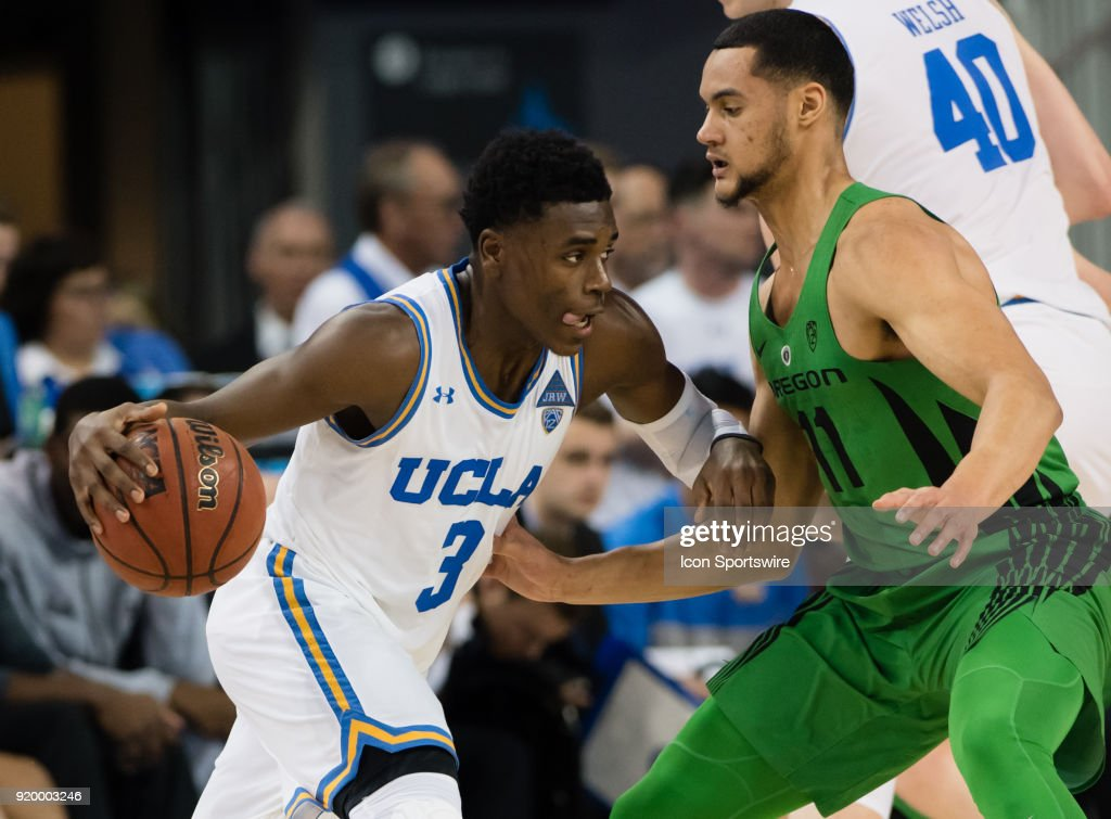 Bruins guard Aaron Holiday (3) drives to the basket against Oregon Ducks forward Keith Smith (11) during the game between the Oregon Ducks and the UCLA Bruins on February 17, 2018, at Pauley Pavilion in Los Angeles, CA.