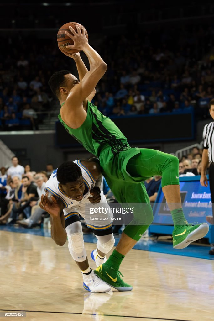 Bruins guard Aaron Holiday (3) gets tangled up with Oregon Ducks guard Elijah Brown (5) during the game between the Oregon Ducks and the UCLA Bruins on February 17, 2018, at Pauley Pavilion in Los Angeles, CA.