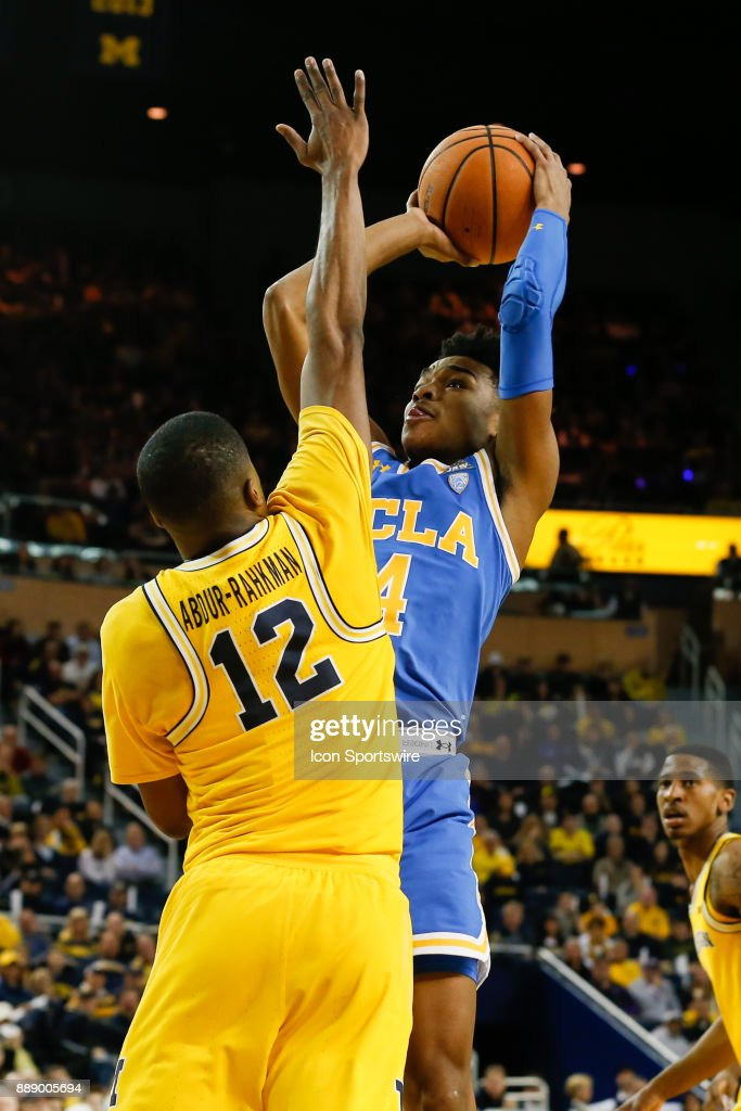 Bruins guard Jaylen Hands (4) shoots over Michigan Wolverines guard Muhammad-Ali Abdur-Rahkman (12) during the second half of a regular season non-conference basketball game between the UCLA Bruins and the Michigan Wolverines on December 9, 2017 at the Crisler Center in Ann Arbor, Michigan. Michigan defeated UCLA 78-69 in overtime.