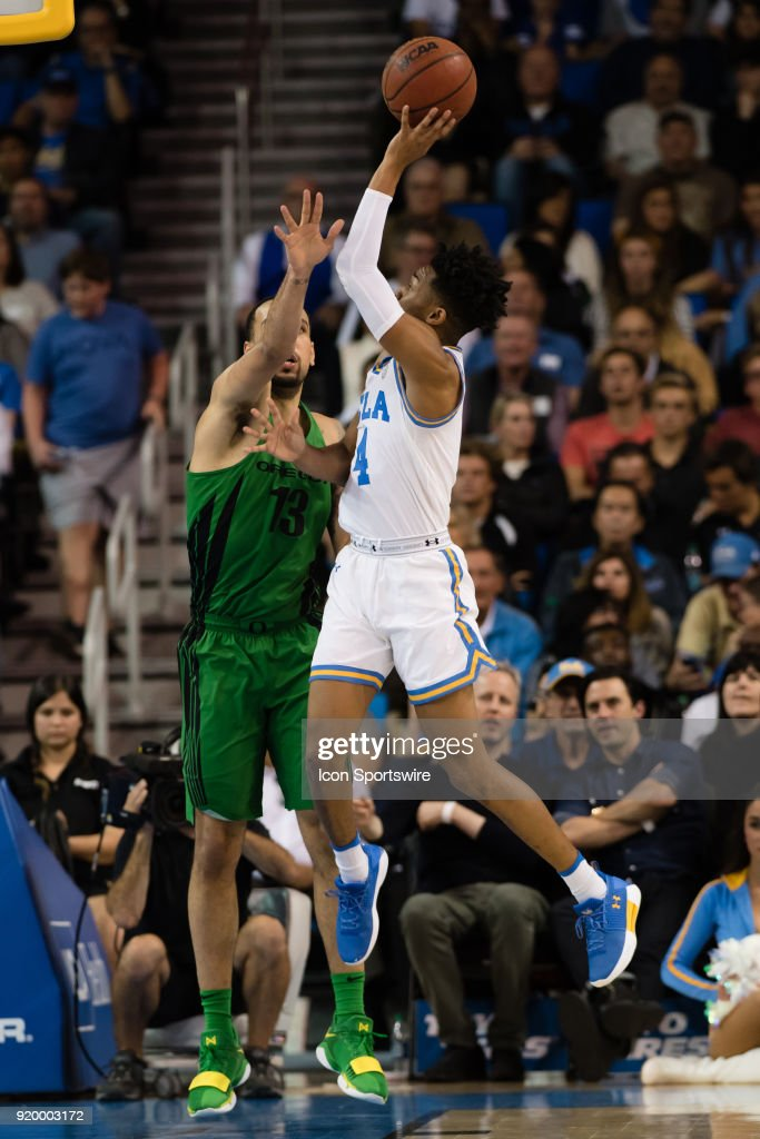 Bruins guard Jaylen Hands (4) shoots over Oregon Ducks forward Paul White (13) during the game between the Oregon Ducks and the UCLA Bruins on February 17, 2018, at Pauley Pavilion in Los Angeles, CA.