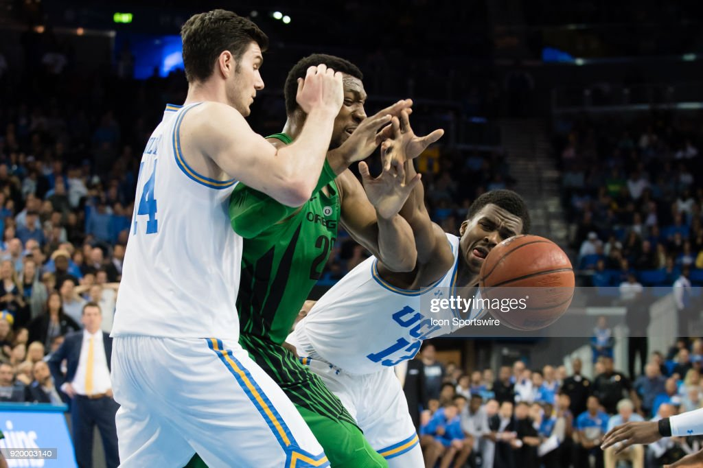 Bruins guard Kris Wilkes (13) and UCLA Bruins forward Gyorgy Goloman (14) defend against Oregon Ducks forward MiKyle McIntosh (22) as he looses control of the ball during the game between the Oregon Ducks and the UCLA Bruins on February 17, 2018, at Pauley Pavilion in Los Angeles, CA.
