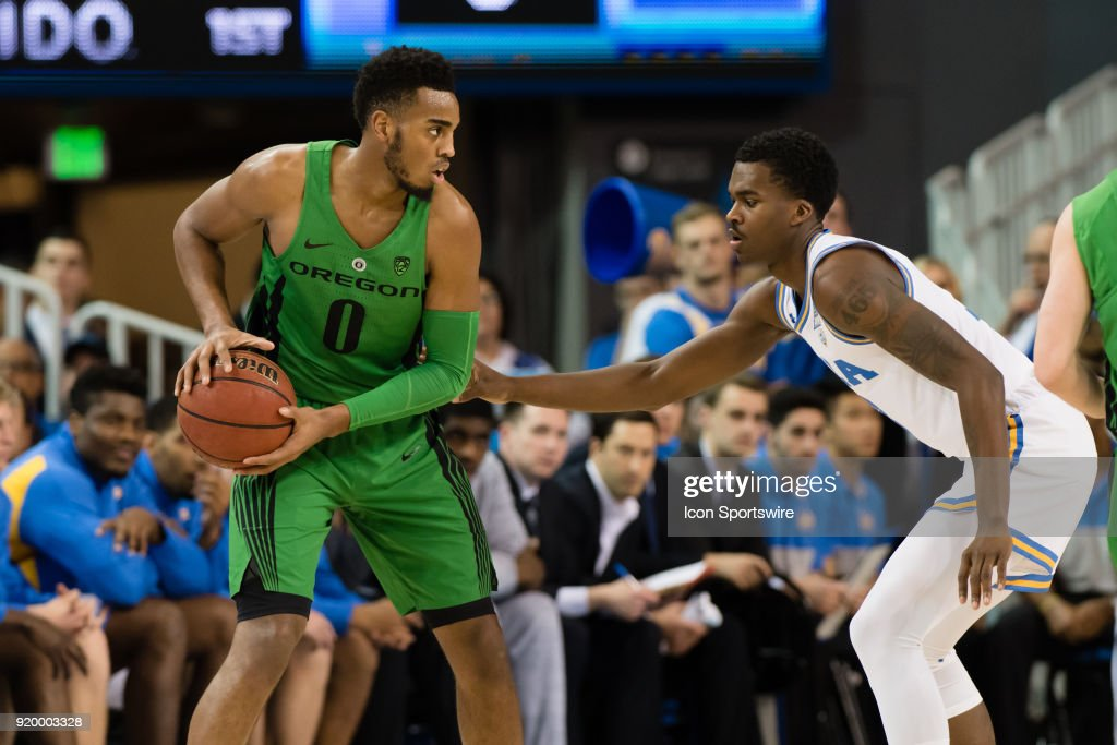 Bruins guard Kris Wilkes (13) defends Oregon Ducks forward Troy Brown (0) during the game between the Oregon Ducks and the UCLA Bruins on February 17, 2018, at Pauley Pavilion in Los Angeles, CA.