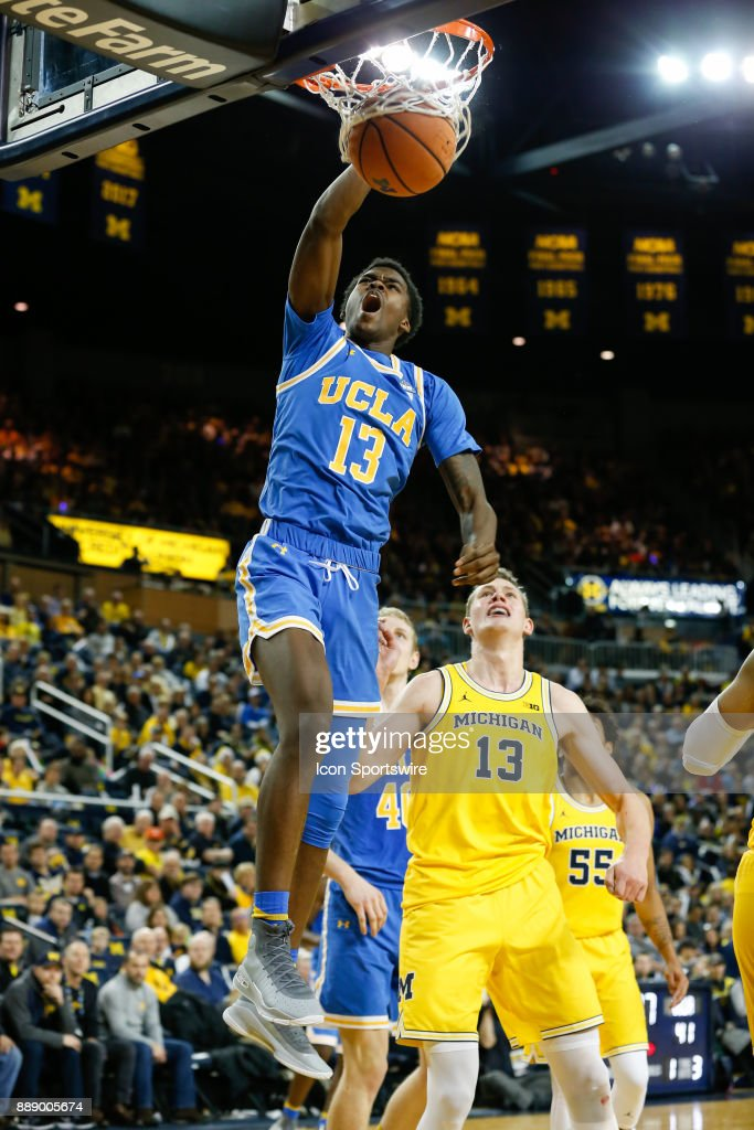 Bruins guard Kris Wilkes (13) dunks the ball during the second half of a regular season non-conference basketball game between the UCLA Bruins and the Michigan Wolverines on December 9, 2017 at the Crisler Center in Ann Arbor, Michigan. Michigan defeated UCLA 78-69 in overtime.