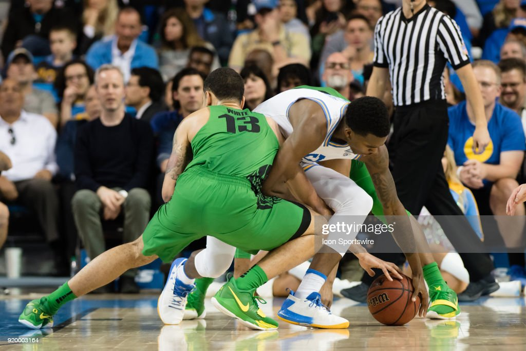 Bruins guard Kris Wilkes (13) fights for a loose ball against Oregon Ducks forward Paul White (13) during the game between the Oregon Ducks and the UCLA Bruins on February 17, 2018, at Pauley Pavilion in Los Angeles, CA.