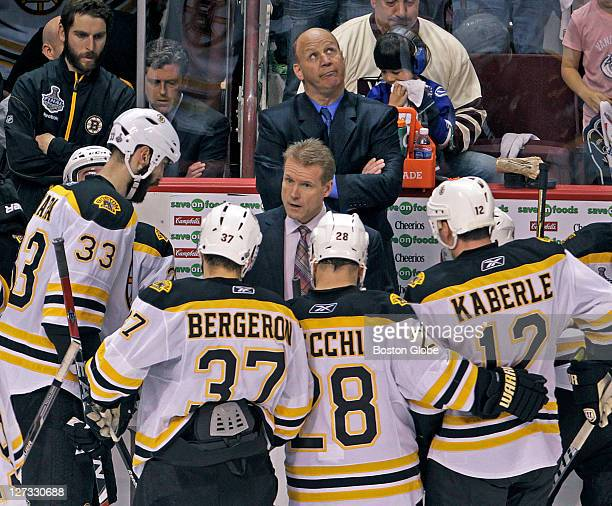 Bruins head coach Claude Julien rear looks at the scoreboard as his team tries to come up with a winning strategy in the last minute of the game...