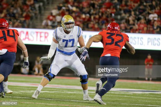 Bruins offensive lineman Kolton Miller goes to block Arizona Wildcats defensive end DeAndre' Miller during a college football game between the UCLA...