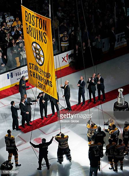 Bruins players and executives raise the Championship Banner The Boston Bruins opened up the 201112 NHL regular season at the TD Garden vs the...