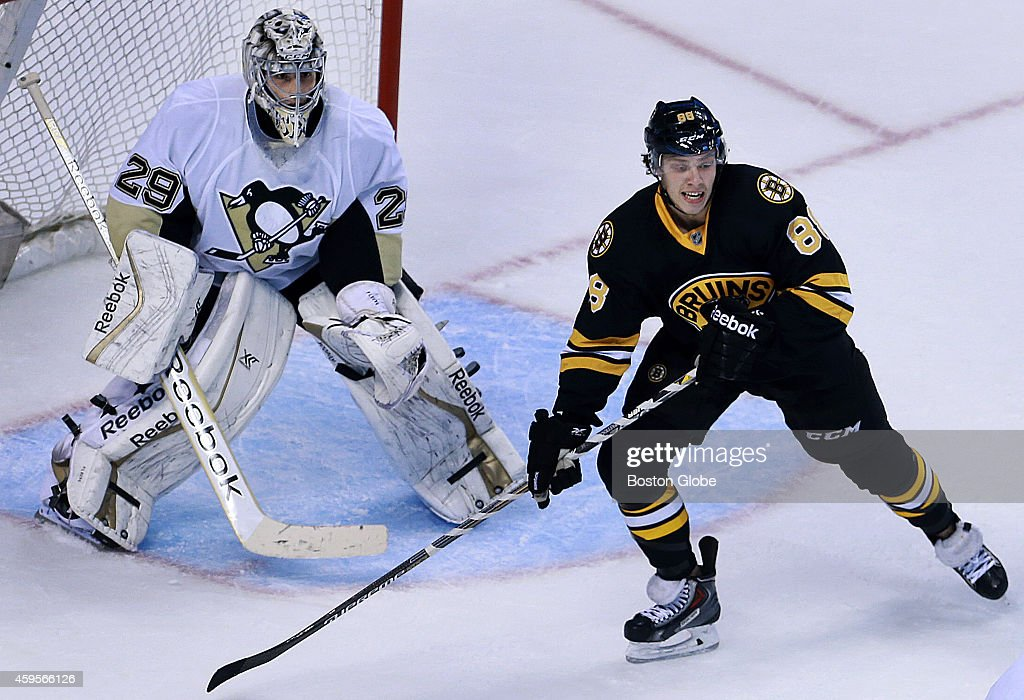 Bruins rookie winger David Pasternak front who made his NHL debut on November 24 is pictured as he waits for a pass in front of Penguins goalie...