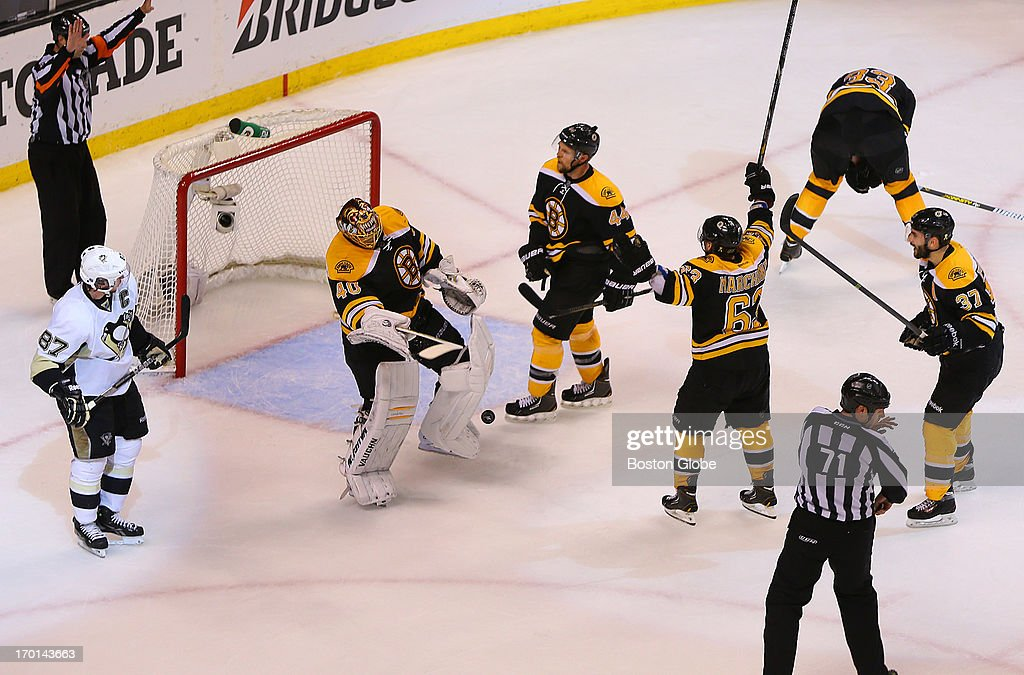 Bruins Tuukka Rask celebrates with Dennis Seidenberg, Brad Marchand, and Patrice Bergeron after beating the Penguins. Penguins Sidney Crosby, left, skates by. The Boston Bruins played the Pittsburgh Penguins in Game Four of the Eastern Conference Finals at TD Garden in Boston, June 7, 2013.