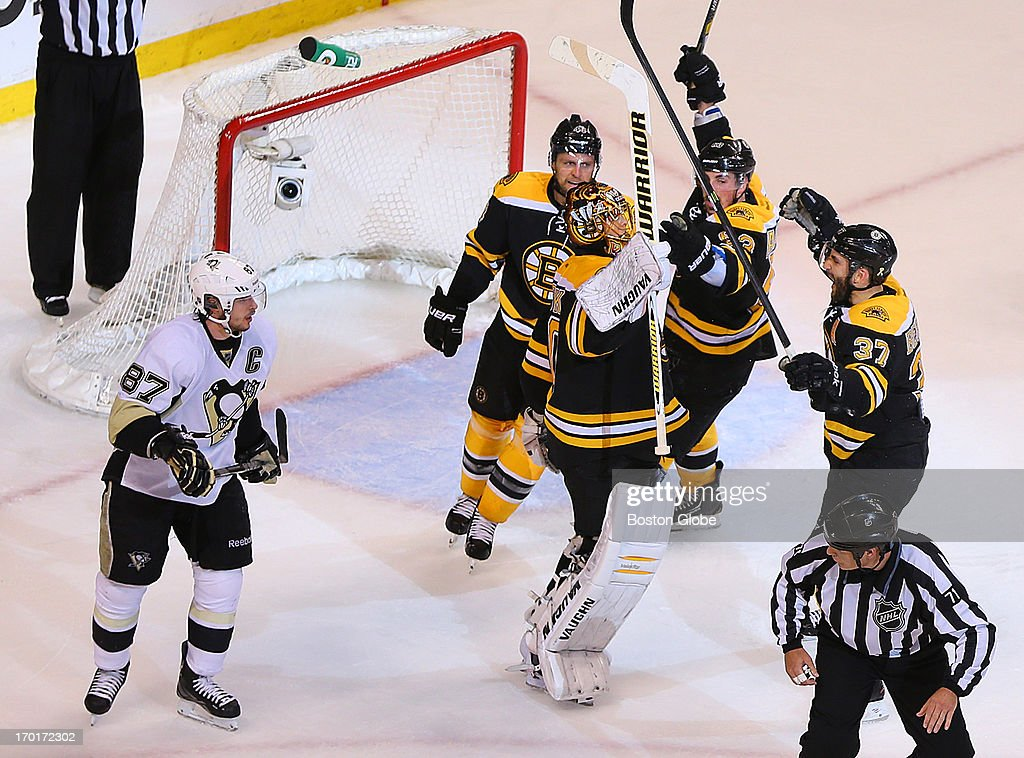 Bruins Tuukka Rask celebrates with Dennis Seidenberg, Brad Marchand, and Patrice Bergeron after beating the Penguins. Penguins Sidney Crosby skates by. The Boston Bruins played the Pittsburgh Penguins in Game Four of the Eastern Conference Finals at TD Garden in Boston, June 7, 2013.