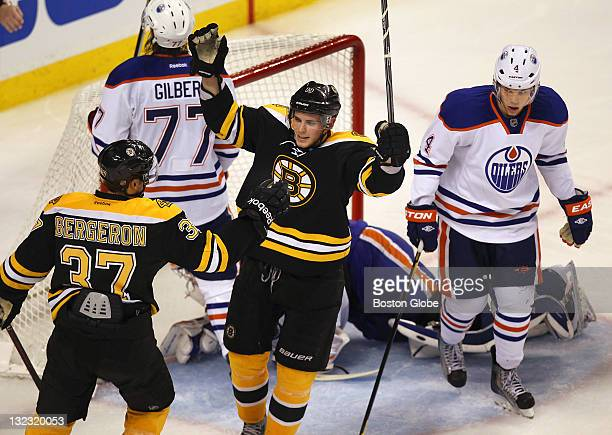 Bruins Tyler Seguin celebrates his second period goal with Patrice Bergeron which put the Bruins ahead 42 as Oilers Taylor Hall right gives a look