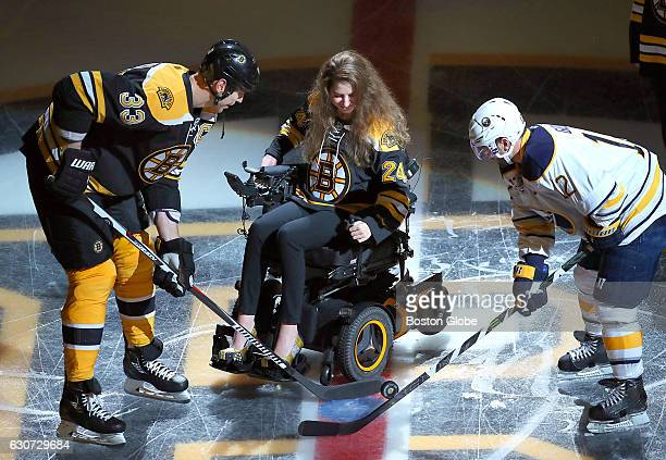 Bruins Zdeno Chara and Sabres Brian Gionta have the puck dropped to them by Denna Laing before the game It has been almost a year sine Laing suffered...