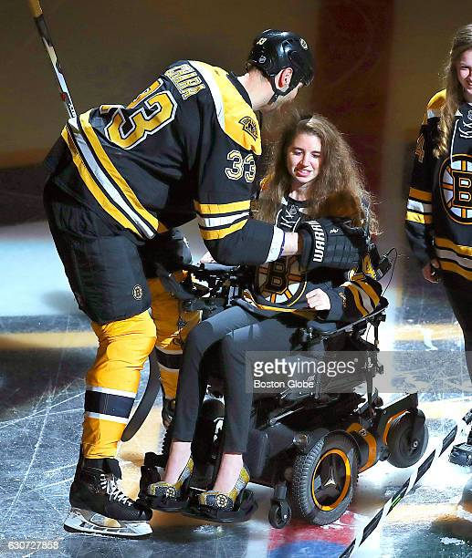Bruins Zdeno Chara gives a hug to Denna Laing as she dropped the puck before the game It has been almost a year sine Laing suffered a spinal cord...