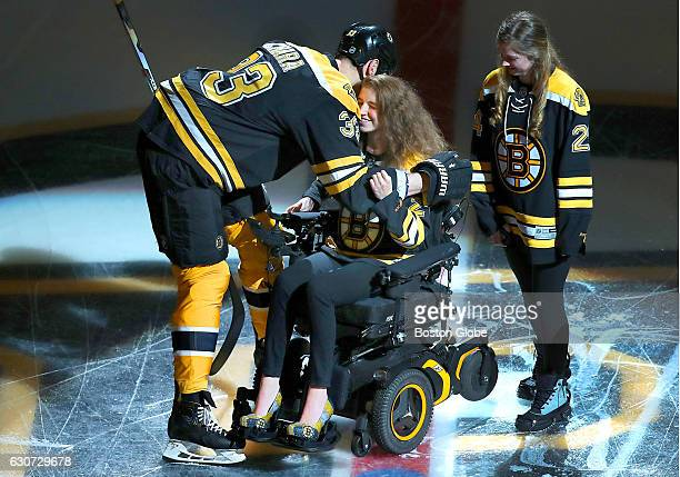 Bruins Zdeno Chara gives a hug to Denna Laing before she dropped the puck before the game It has been almost a year sine Laing suffered a spinal cord...