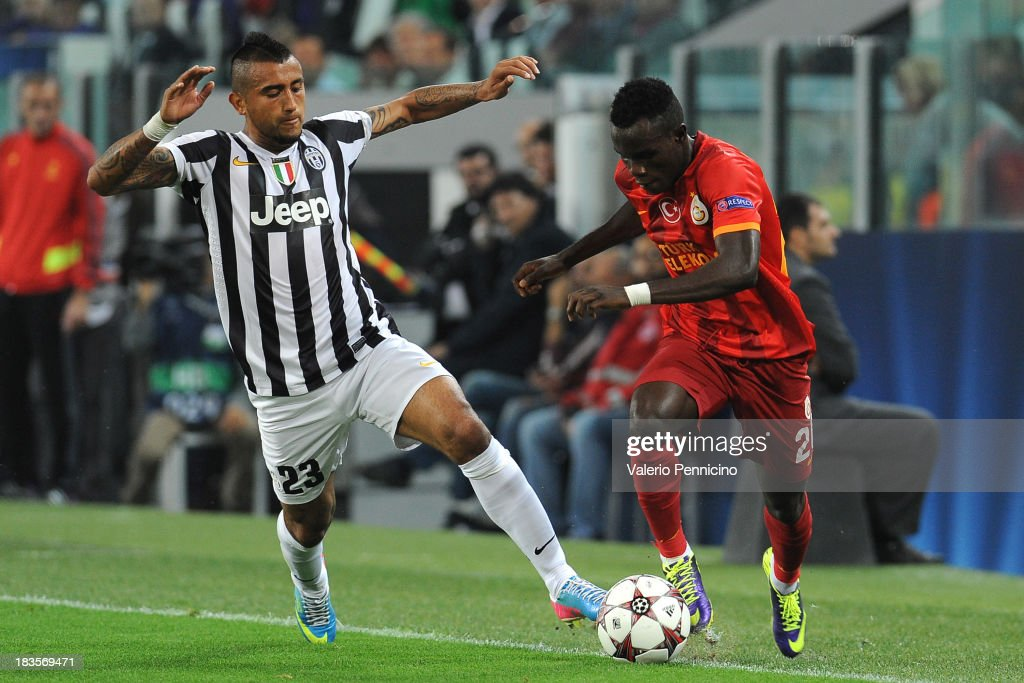 Bruma (R) of Galatasaray AS is challenged by Arturo Vidal of Juventus during UEFA Champions League Group B match between Juventus and Galatasaray AS at Juventus Arena on October 2, 2013 in Turin, Italy.