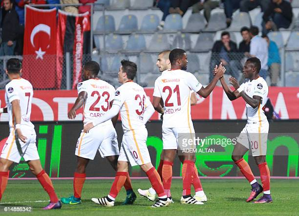 Bruma of Galatasaray is congratulated by teammates after scoring a goal during the Turkish Super Lig football match between Genclerbirligi and...