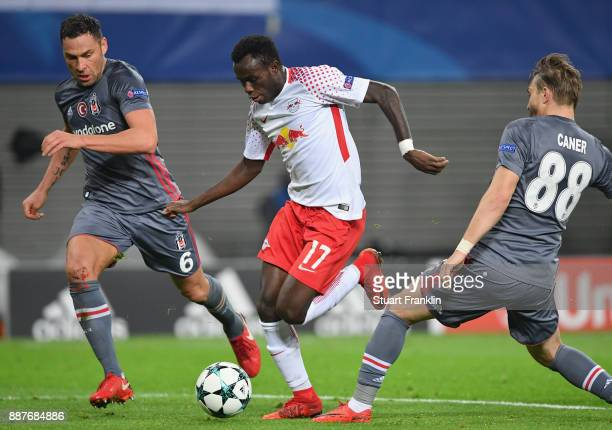 Bruma of Leipzig is challenged by Caner Erkin of Besiktas during the UEFA Champions League group G match between RB Leipzig and Besiktas at Red Bull...