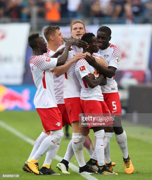 Bruma of Leipzig of Leipzig celebrates after scoring his team's fourth goal with team mates during the Bundesliga match between RB Leipzig and...