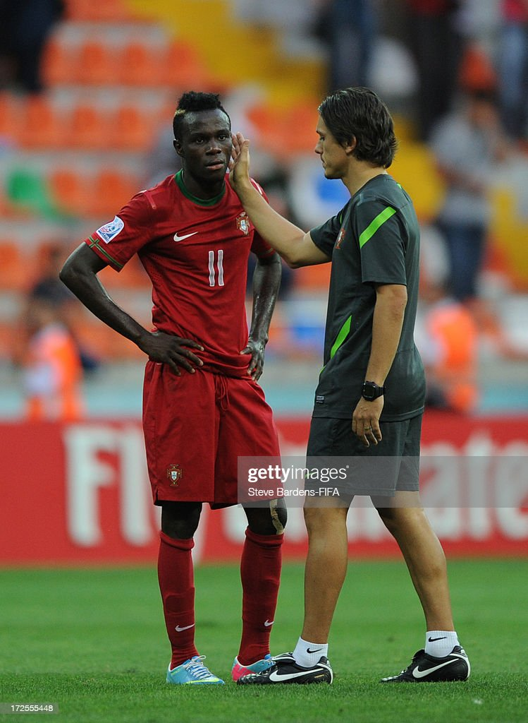 Bruma of Portugal looks dejected and is consoled by a member of the Portugal backroom staff after Portugal lose to Ghana during the FIFA U20 World Cup Round of 16 match between Portugal and Ghana at Kadir Has Stadium on July 3, 2013 in Kayseri, Turkey.