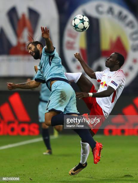 Bruma of RB Leipzig and Sergio Oliveira of FC Porto battle for posession during the UEFA Champions League group G match between RB Leipzig and FC...