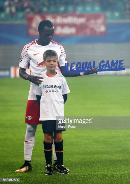 Bruma of RB Leipzig poses with a Player Escourt prior to the UEFA Champions League group G match between RB Leipzig and FC Porto at Red Bull Arena on...