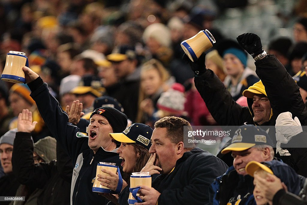 Brumbies fans celebrate during the round 14 Super Rugby match between the Brumbies and the Sunwolves at GIO Stadium on May 28, 2016 in Canberra, Australia.