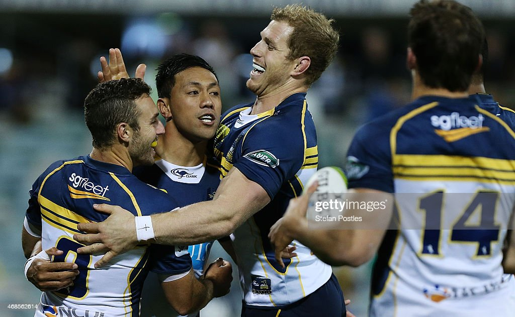 Brumbies players celebrate a try by <a gi-track='captionPersonalityLinkClicked' href=/galleries/search?phrase=Christian+Lealiifano&family=editorial&specificpeople=603579 ng-click='$event.stopPropagation()'>Christian Lealiifano</a> during the round eight Super Rugby match between the Brumbies and the Cheetahs at GIO Stadium on April 4, 2015 in Canberra, Australia.