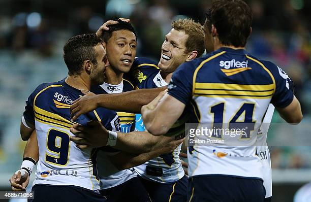 Brumbies players celebrate a try by Christian Lealiifano during the round eight Super Rugby match between the Brumbies and the Cheetahs at GIO...