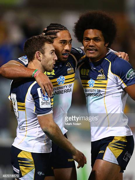 Brumbies players celebrate a try by Joe Tomane during the round 19 Super Rugby match between the Brumbies and the Force at Canberra Stadium on July...