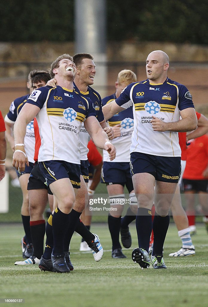 Brumbies players celebrate a try during the Super Rugby trial match between the Brumbies and the ACT XV at Viking Park on February 8, 2013 in Canberra, Australia.