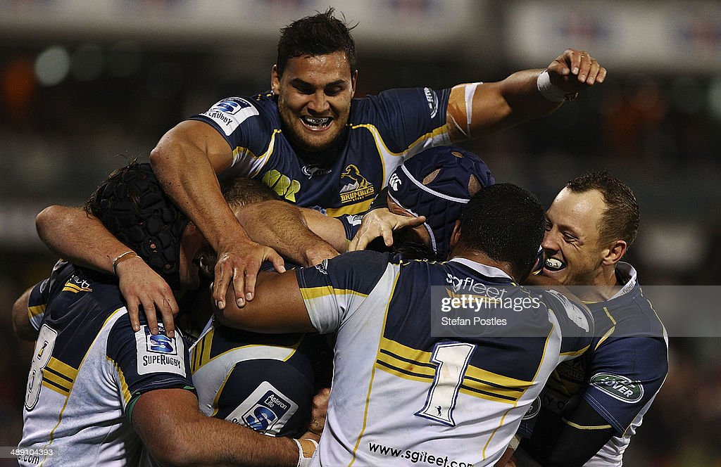 Brumbies players celebrate after a try by <a gi-track='captionPersonalityLinkClicked' href=/galleries/search?phrase=Sam+Carter+-+Rugby+Player&family=editorial&specificpeople=13506926 ng-click='$event.stopPropagation()'>Sam Carter</a> during the round 13 Super Rugby match between the Brumbies and the Sharks at Canberra Stadium on May 10, 2014 in Canberra, Australia.