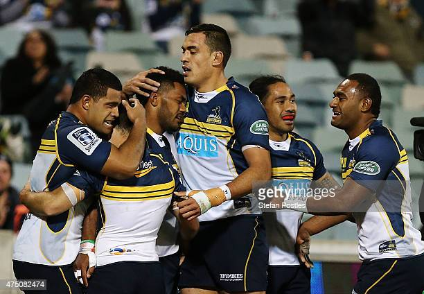 Brumbies players celebrate after Henry Speight scored a try during the round 16 Super Rugby match between the Brumbies and the Bulls at GIO Stadium...