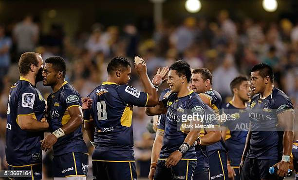 Brumbies players celebrate victory in the round two NRL match between the Brumbies and the Waratahs at GIO Stadium on March 4 2016 in Canberra...