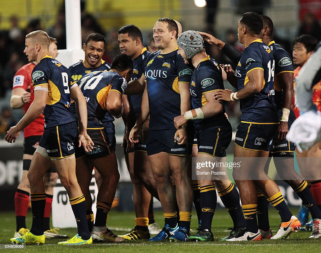 Brumbies players celebrate with Ruan Smith after he scored a try during the round 14 Super Rugby match between the Brumbies and the Sunwolves at GIO Stadium on May 28, 2016 in Canberra, Australia.